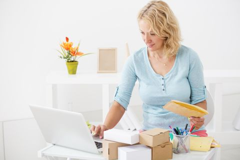 Woman organizing packages for delivery