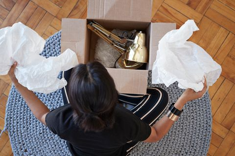 Woman packaging a lamp