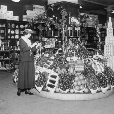 vintage photo of grocery store   woman shopping for fruit