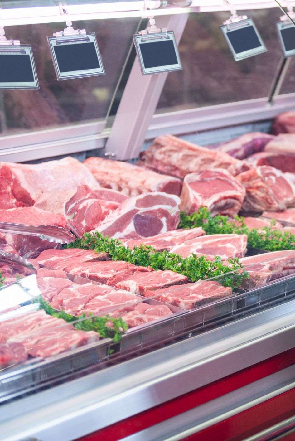 Woman pointing at meat in display