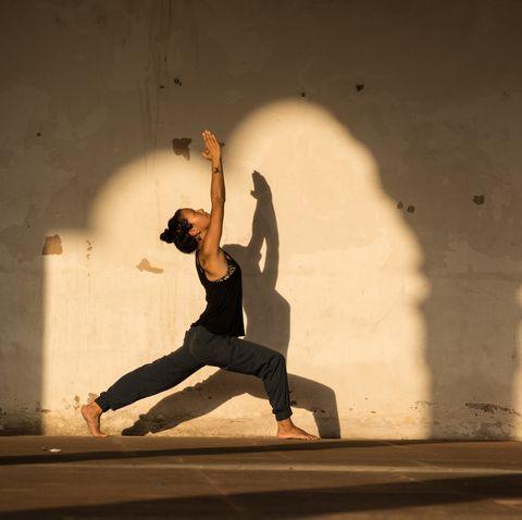 woman practicing yoga in india