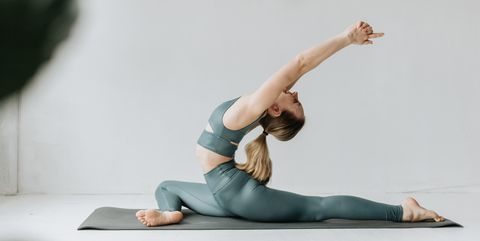 Woman practising yoga in studio