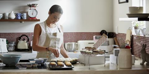 woman preparing cupcakes in kitchen
