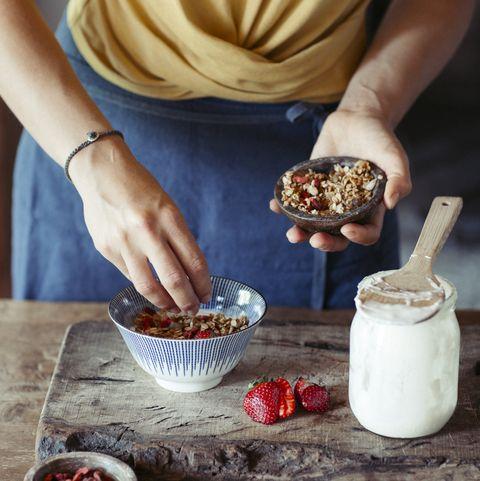 woman preparing muesli