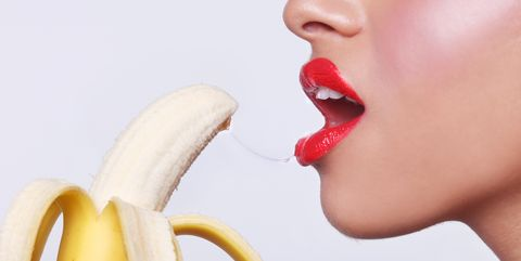 Woman Preparing to Eat a Banana