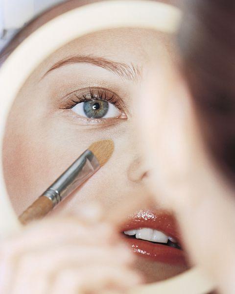 Woman Putting on Make Up