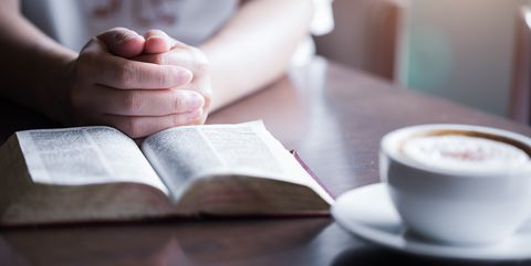 Woman reading holy bible.,Reading a book.