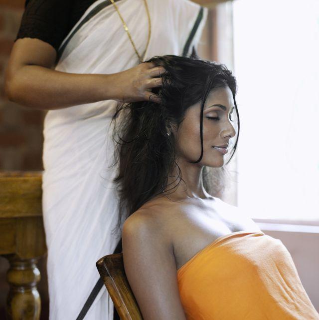 woman receiving pizhichil, ayurvedic oil bath