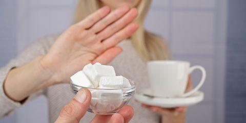 woman refuses white sugar
