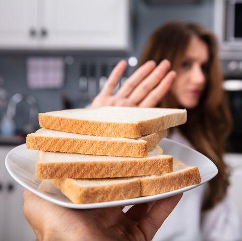 Woman Refusing Bread Slice