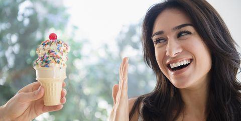 Woman refusing ice cream cone