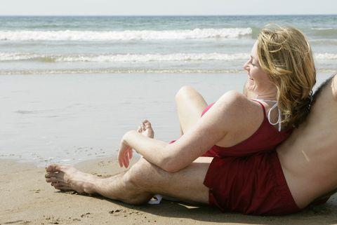 woman relaxing by beach