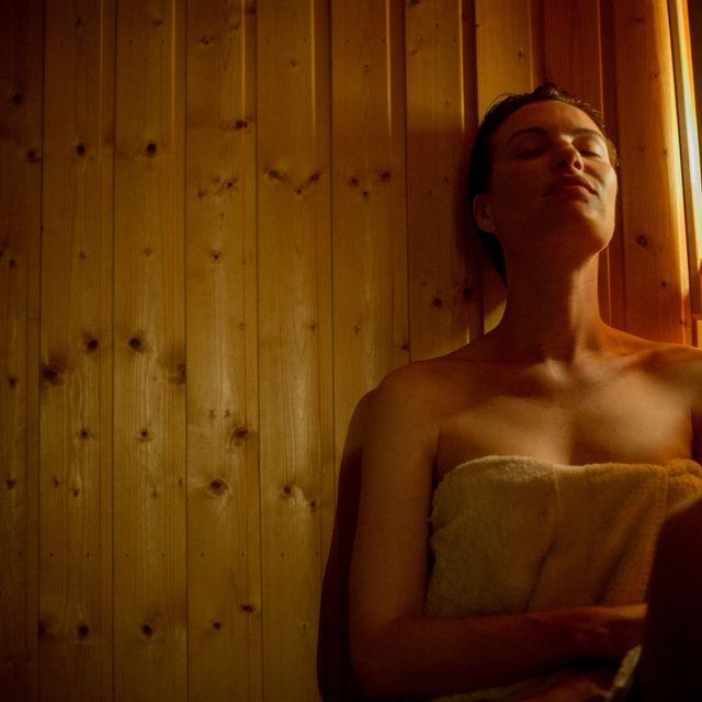 Woman relaxing in sauna