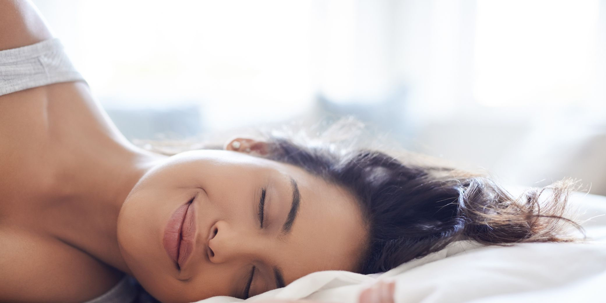 Woman relaxing on her bed in the morning at home