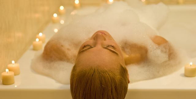 woman relaxing peacefully in a spa resort