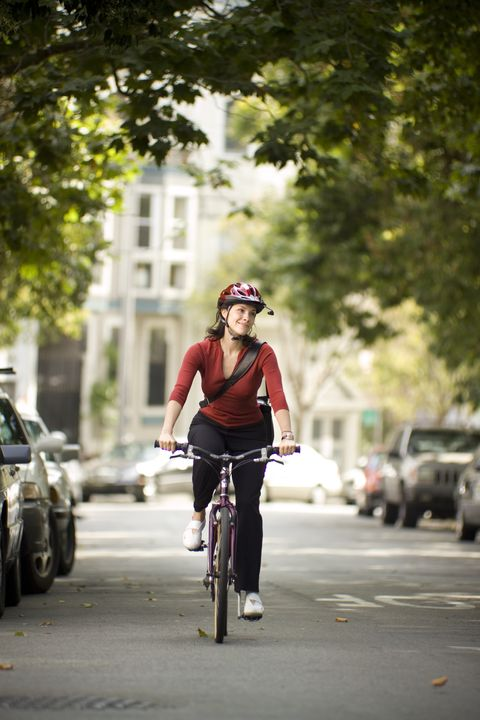 woman riding bicycle on city street