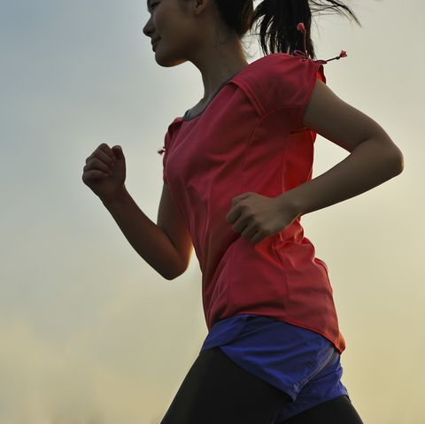 woman running for exercise at sunset
