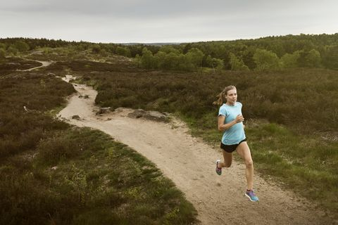 Woman running on graveled road