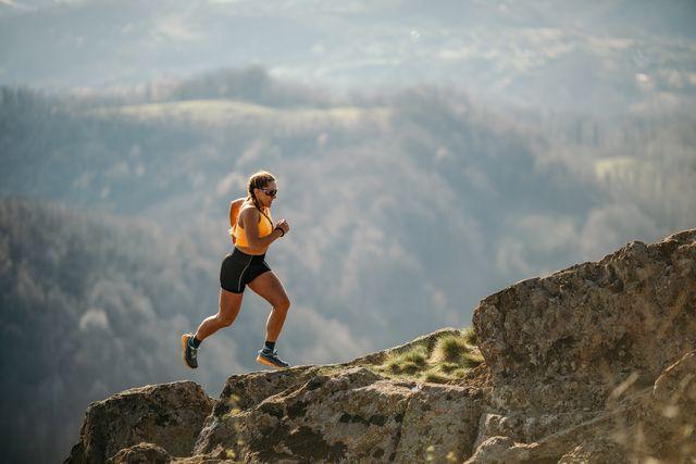 woman running on mountain