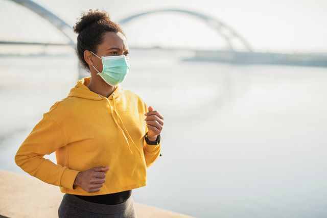 woman running with protective face mask