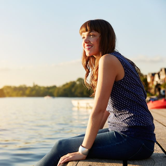 woman sat on river jetty