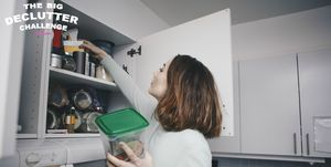 Woman searching kitchen cabinet