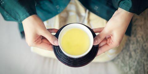 woman serving japanese tea