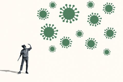 woman shielding eyes by large green coronavirus