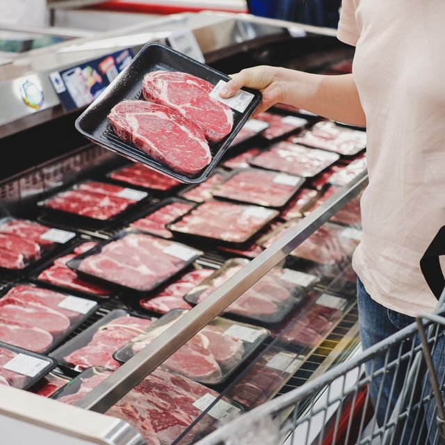 woman shopping at meat section