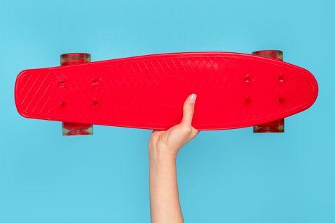 Woman showing modern red longboard