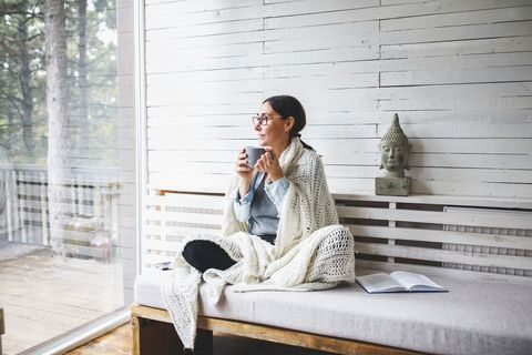 woman sitting comfortable and looking through the window