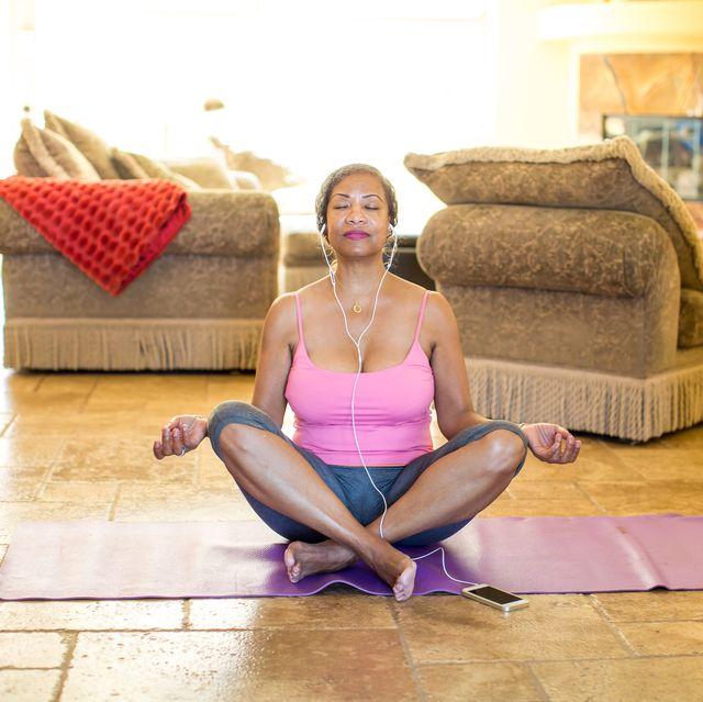 woman sitting cross legged meditating