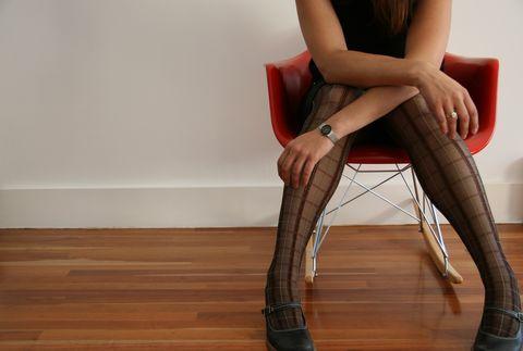 Woman sitting in eames rocker