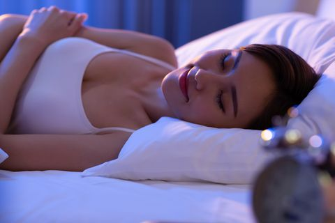 woman sleep well on bed