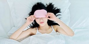 woman sleeping in sleep mask