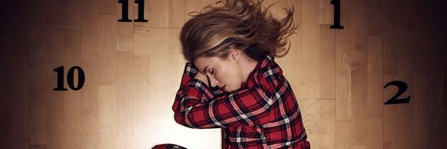 woman sleeping on clock