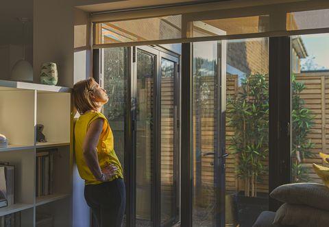 woman standing by her back door