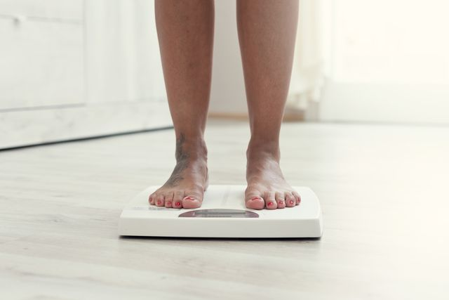woman standing on the weight scale