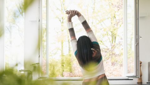 Woman stretching in kitchen
