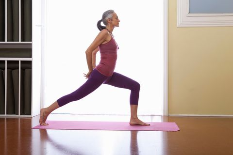 woman stretching legs with hands behind back