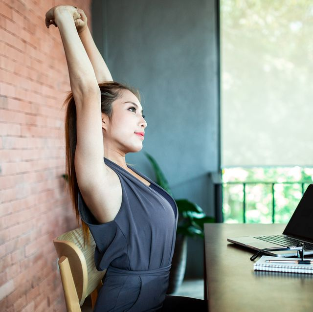 woman stretching relaxation at office