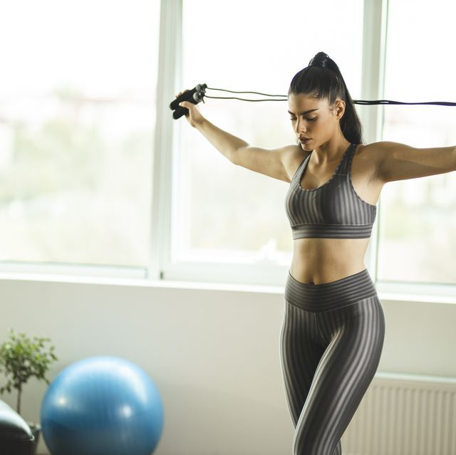 woman stretching with jumping rope