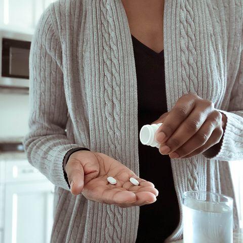 woman takes medication