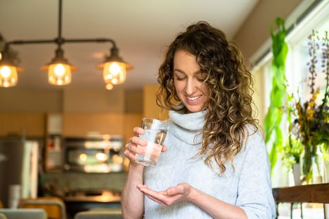 woman taking daily supplements or medication