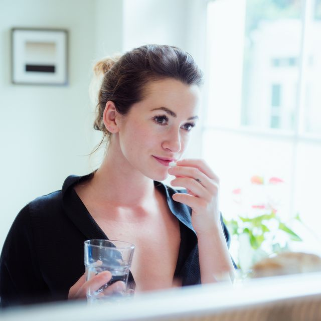 woman taking vitamins and supplements