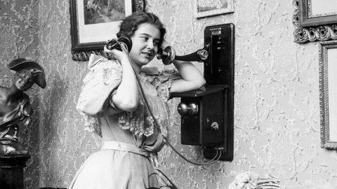 Woman Talking On The Telephone Early
