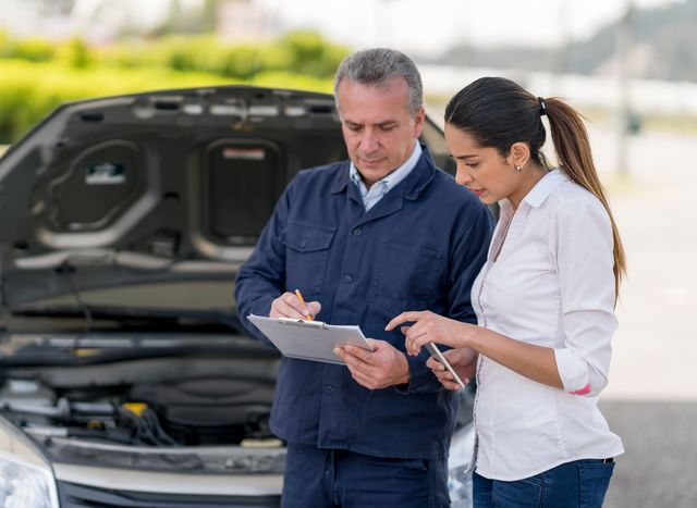 woman talking to a mechanic about her car