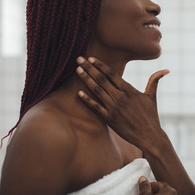 a woman touching her neck