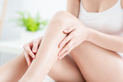 woman touching perfect shaved legs