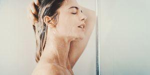 Woman under a relaxing shower.